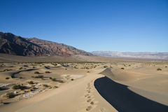 Path on a sand dune. Footprint path on a sand dune in Death Valley National Park Stock Images