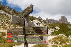 Path sign. Wood path sign at Dolomites Alps (Italy Royalty Free Stock Photo