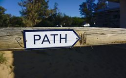 Path sign on wooden gate pointing to the right stock photos
