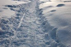 Path on the snow. Path on the shiny snow stock photos