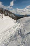 Path through the snow. Running pass chimney Royalty Free Stock Photo