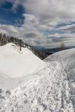 Path through the snow. Running pass chimney Royalty Free Stock Photos