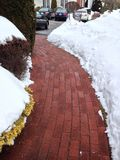 Path through the Snow. Brick walkway with snow on each side Stock Image