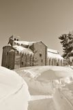 Path in the snow to the old church Stock Photography