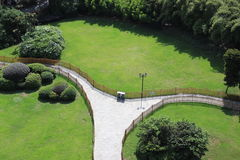 Path. Standing on a height looking down, a path in the park lawn Royalty Free Stock Photos
