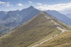 Path on the steep side of Kasprowy Wierch in Tatra mountains and Royalty Free Stock Image