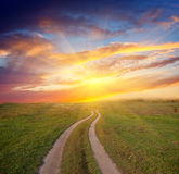 Path in steppe to sunset royalty free stock photos