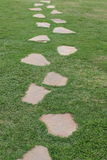 Path. Stepping stones set in a path along the grass Stock Photo