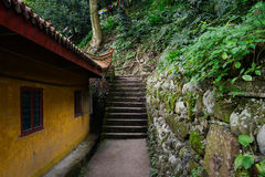 Path and steps behind ancient Chinese building on mountainside Stock Image