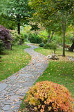 Path from stone in autumn park Stock Image