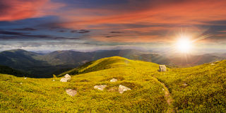 Path among stones on mountain top at sunset Royalty Free Stock Photography