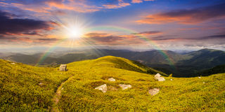 Path among stones on mountain top at sunset Royalty Free Stock Photo