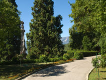 Path in subtropical park with column near Massandra Palace. In Crimea Royalty Free Stock Images