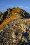 Path on summit. Trail leading to the peak during the sunrise. Path in Polish Tatra mountains royalty free stock photos