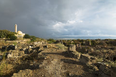 Path with sunlight during storm in ruins with dramatic cloudscape in Tyre, Sour, Lebanon Stock Photography