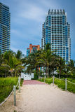 Path to the beach and highrises in South Beach, Miami, Florida. Stock Images