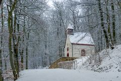 Path to Burg Eltz. Small wooden church in winter near the german castle Burg Eltz. Touristic path to castle Royalty Free Stock Image