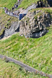 Path to the The Carrick a rede in Northern Ireland. People climbing the path to Carrick a rede Bridge, Northern Ireland, Europe Royalty Free Stock Images