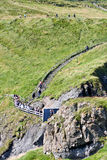 Path to the The Carrick a rede in Northern Ireland. People climbing the path to Carrick a rede Bridge, Northern Ireland, Europe Royalty Free Stock Photography