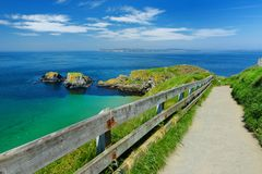 Path to Carrick-a-Rede Rope Bridge, famous rope bridge near Ballintoy in County Antrim, Nothern Ireland royalty free stock photos