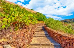 Path to the castle of Malaspina above the village of Bosa on a sunny day - Sardinia. Ancient, antique, architecture, bricks, buildings, cross, effect, facade stock images
