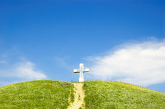 Path to the cross. On the top of green hill Royalty Free Stock Photo