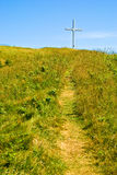 Path to the cross. Path to a mountain top cross, Magdalen Islands, Iles de la Madeleine, Quebec royalty free stock photo