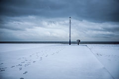 Path to enlightenment. Snow covered beach with footprints leadin Royalty Free Stock Photos