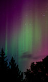 Path to Heaven. Green aurora paints the night sky Royalty Free Stock Photo