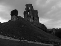 A path to a hilltop ruin. A hilltop ruin pictured in black and white gives contrast against the cloudy sky stock images