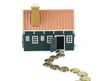 Path to homeownership - isolated. House with devious money path leading to it - isolated (clipping path royalty free stock image