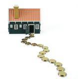 Path to homeownership - isolated. House at the end of a long and devious money path - isolated (clipping path stock image