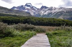Path to Laguna Esmeralda in Tierra del Fuego park near Ushuaia, Paragonia, Argentina. Hiking trail to Laguna Esmeralda in Tierra del Fuego park near Ushuaia stock photo
