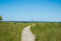 Path To Lake Michigan. A pathway along the Sheboygan beachfront resting between beautiful green grass royalty free stock photos