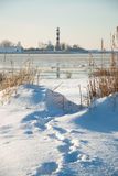 Path to lighthouse between sand dunes in winter Royalty Free Stock Photo