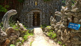 Path to Modern Church Built with Crude Stones Through Gate stock video footage