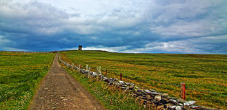 Path to Moher Tower along the Cliffs of Moher Stock Photo