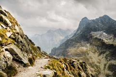Path to the mountain peak over the precipice royalty free stock image
