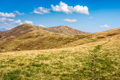 Path to the mountain top. Mountain landscape. travers path through hill side to the mountain top Royalty Free Stock Images