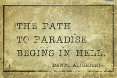 Path to paradise Dante. The path to paradise begins in hell - ancient Italian poet and philosopher Dante Alighieri quote printed on grunge vintage cardboard royalty free illustration