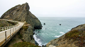 Path to Point Bonita Lighthouse. Rocks and shoreline on a typical overcast and foggy day at the San Francisco Bay entrance royalty free stock photo