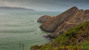 Path to Point Bonita Lighthouse and coastline. The path to Point Bonita Lighthouse on a typical overcast and foggy day at the San Francisco Bay entrance stock images