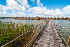 Walkway to bungalows in a lagoon Royalty Free Stock Photography