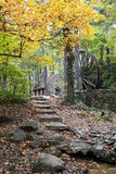 Path to Rustic water mill Stock Image