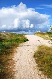 Path to the sea. Path to the Baltic sea, clouds in foreground. Travel Europe, Latvia shore Royalty Free Stock Image