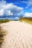 Path to the sea. Path to the Baltic sea, clouds in foreground. Travel Europe, Latvia shore Stock Photos