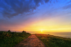 Path to the sea. With beautiful sunset Stock Photo