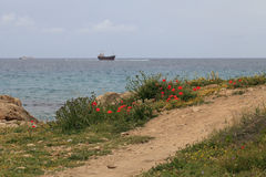The path to the sea and the ship aground. Cyprus. Pathos. Royalty Free Stock Images