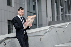 Path to success. Young and handsome man reading a newspaper. Bus Royalty Free Stock Photography