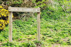 Path to summit. Sign indicating the path to the summit of a hill Royalty Free Stock Photography